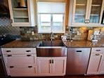 Fully equipped kitchen with stainless steel appliances, gas cook top stove and granite counter tops.