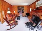 Lower level raised living room with cable flat screen TV/VCR/DVD, wood burning fireplace, couch, rocker, two arm chairs...