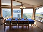 Large dining table for eleven, beautiful ocean views and door to wrap around deck.