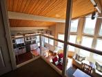 Upper level loft with futon that overlooks living area.