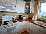 Fully equipped kitchen with beautiful ocean views, all appliances, breakfast bar for four.