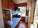 Upper level fifth bedroom with a standard Twin bunk bed.