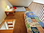 Upper level sleeping loft with two twin mattresses-ocean looks living area with beautiful ocean views.
