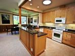 Fully equipped kitchen with gas cook stove that is open to the living and dining areas.