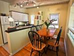 Fully equipped kitchen with all appliances and dining area for 6.  French doors that takes you to the backyard area.