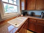 Upper level large fully equipped kitchen with all appliances, breakfast bar for four and a small desk.