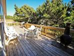 Large gated wrap around deck with gas BBQ, portable fireplace and ample deck furniture.