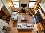 Lower entry level living room with wall mounted flat screen cable TV/DVD, gas fireplace, couch, loveseat, 3-disc CD...