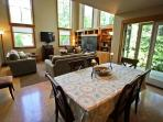 Dining table for eight with french doors leading to side deck.