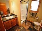 Lower level hall bathroom with stall shower.
