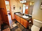 Upper level hall bathroom with his & her sinks and a tub/shower combo.
