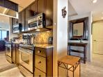 Fully equipped with stainless steel stove with oven, convection microwave and small appliances.