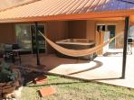 Back patio with hot tub, hammock and bbq. Easy access from back sliding glass door.