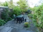 Relax in the enclosed garden- a real suntrap