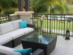 Large Terrace overlooking Resort's main lake accessible from Master bedroom and Living Room.