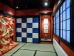 The 'Geisha Room' with tatami mats. A traditional wedding kimono decorates the wall.