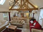 Cook, eat and relax together in the huge oak beaned kitchen, dining area and lounge