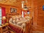 Main Level Bedroom with King Bed at Tree Top Lodge