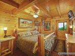 Master Bedroom with King Bed and Jacuzzi at Wild Bill's Hideout