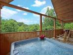 Covered Deck with Hot Tub at Swept Away