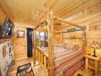 First Floor King Bedroom with Log Canopy Bed at Natural Wonder