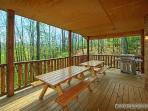 Covered Deck with Picnic Tables and Grill at Making Memories Lodge