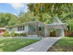 House is situated on a tree lined street. residential neighborhood