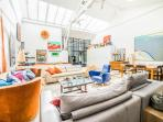 Living Room upstairs. Original artist studio with massive skylight, electric shutters.