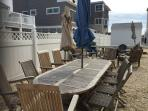 Teak table seats 10+ use stacking chairs if needed.  Remember to put umbrellas down after use please
