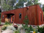 Taos Rio Eco house with weathering steel and stone- welcoming pond with waterfall