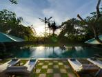 21. Surya Damai - Pool and garden at sunset