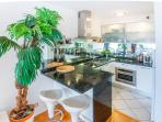Large kitchen with granite top and mirrors