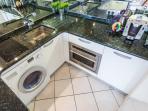 Washing machine/dryer, induction, Oven/micro wave, dishwasher, and normal size fridge