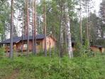 The holiday cottage and its grill house and store cabin are set in the pine forest over one hectare