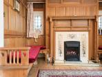 Inglenook fireplace with gas effect fire in the second sitting room