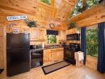 Kitchen with Black Appliances at Smoky Mountain Mist