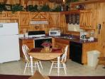Kitchen and Dining Area at Stream Of Love