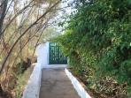 The walk way to the house from the main gate