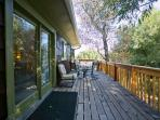 Your entry and llarge private deck overlooking the stream.