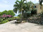 Private parking area with stairs leading to main entrance and path leading to pool deck