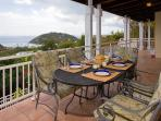 Dine al fresco on covered veranda with a view