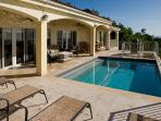 Sliders lead from Great Room spacious Pool Deck for relaxing, grilling, dining, and Ocean Views