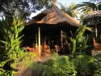 Chill out along the ricefields - charming ironwood and alang-alang tropical villa