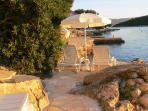 Private beach with sun loungers and parasols for guests only
