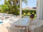Comfortable terrace furniture by the swimming pool