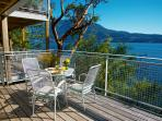 Waterfront deck with dining, BBQ, and views of the Coastal Mtns and as far south as the San Juans.