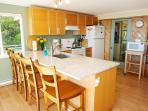 Newly renovated kitchen w/ granite counters and dishwasher plus everything required for in home meal