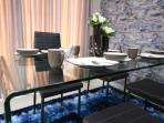 Glass top dining table with complete dining ware
