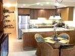 Bamboo kitchen cabinets with granite counters,