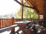 Back Deck with Picnic Table at Waters Edge Lodge